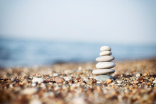 Stones Tower With Blurred Sea Background. Pyramid On The Right. Zen Garden. Spa Set.