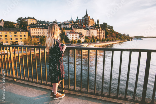 Foto auf Leinwand Stockholm Woman traveling in Stockholm city enjoying view from bridge summer vacations in Sweden