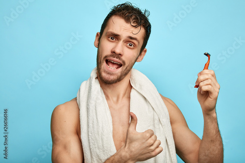 emotional shirtless man going to test anew shaver after bath Canvas Print