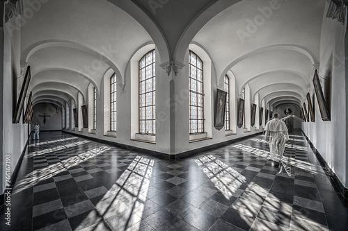 Fotografie, Obraz Hallways of abbey with shadow of friars