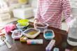 Leinwanddruck Bild - Little girl making homemade slime toy