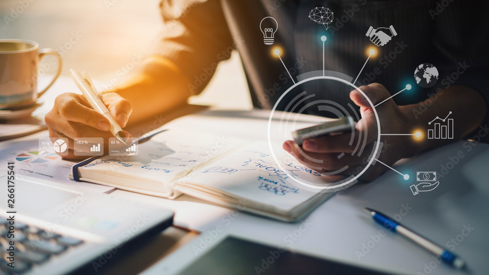 Fototapety, obrazy: Businessman working on project for SWOT analyzing company financial report balance with augmented reality graphics at modern office space. Concept for business, economy, marketing and strategy.