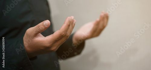 close up adult muslim prayer man hand praying at mosque concept Fototapet