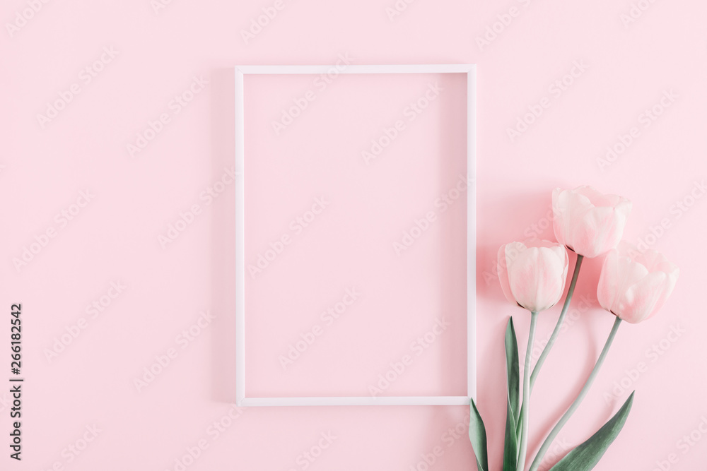 Fototapeta Beautiful composition spring flowers. Blank frame for text, pink tulips flowers on pastel pink background. Valentine's Day, Easter, Birthday, Happy Women's Day. Flat lay, top view, copy space