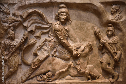 Marble relief carving of the God Mithras slaying the mystic bull second century Rome at ROM Toronto