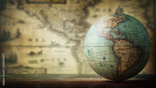 Old globe on vintage map background Canvas Print