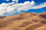 Detailed shot of the shadows on the dunes at Great Sand Dunes National Park in Colorado on a bright sunny but cloudy day