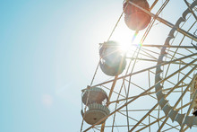 Ferris Wheel On Sky Background. Ferris Wheel On Sunny Sky Background
