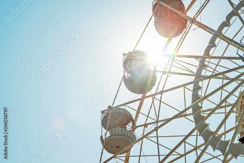 Foto  Ferris wheel on sky background