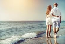 Happy Couple Walking On Beach ...