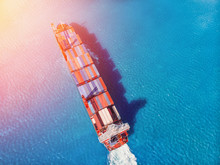 Logistics Transportation Of International Container Cargo Ship In Blue Ocean. Top View Aerial. Concept Shipping