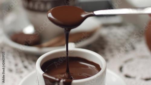 Foto auf AluDibond Schokolade hand mixing chocolate in a hot milk, preparing hot chocolate or cacao, bautiful soft focus shot