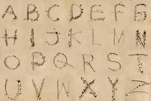 Alphabet Letters Written In The Beach Sand