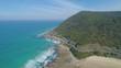 Forward flight towards Great Ocean Road winding along beautiful ocean coastline in Victoria, Australia