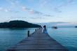 Traveler woman is relaxing on wood bridge in beautiful island, koh kood island, Trat Thailand.