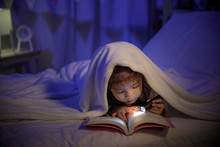 Child Asian Girl Reading A Boo...