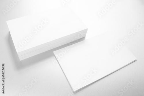 Valokuvatapetti Mockup of business cards on white textured paper background