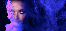 Neon Party. Woman Vaping In Club, Smoke Illuminated By Neon Lights