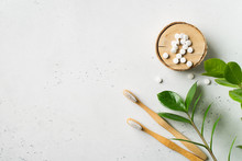 Zero Waste And Minimalism Concept. Wooden Ecological Toothbrushes And Toothpaste Tablet On White Background