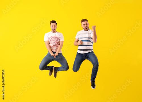 Fotografie, Obraz  Jumping young men on color background