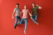 canvas print picture - Jumping young men on color background