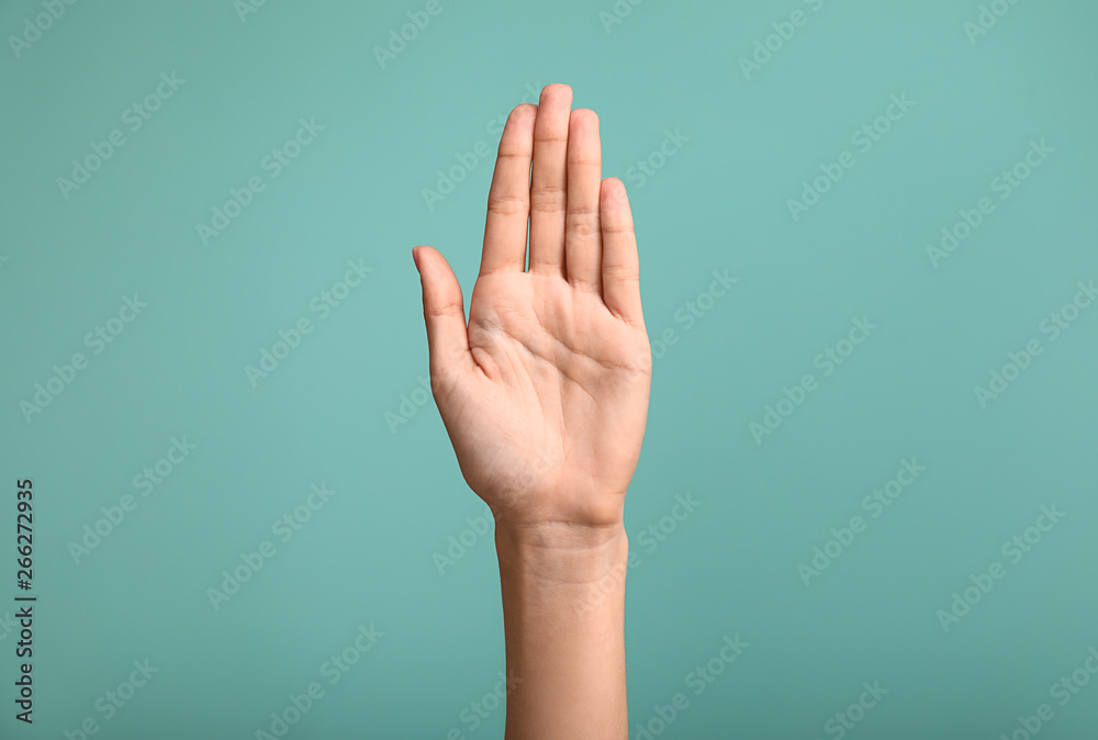 Fototapety, obrazy: Gesturing female hand on color background