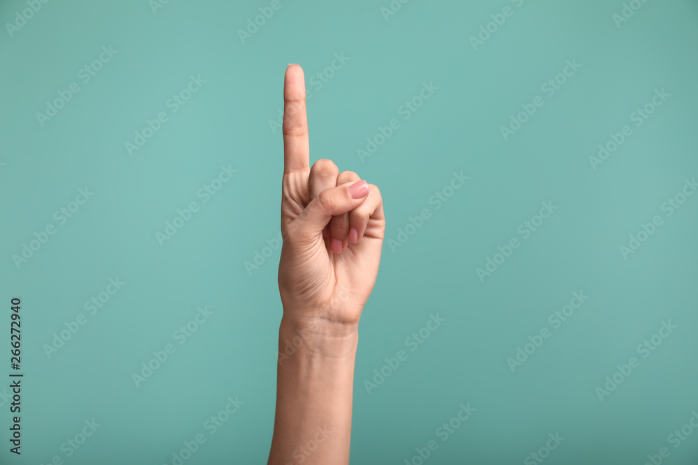 Fototapeta Gesturing female hand on color background