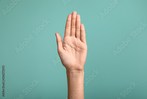Obraz Gesturing female hand on color background - fototapety do salonu