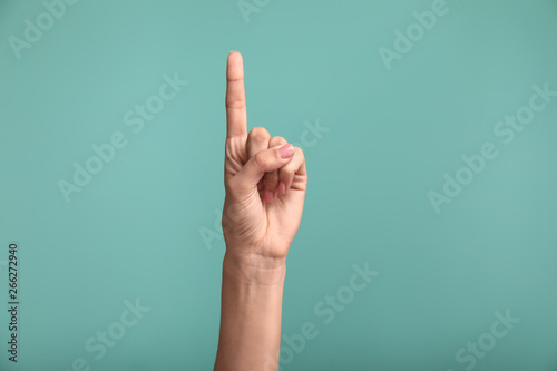 Photo  Gesturing female hand on color background