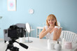 canvas print picture - Mature beauty blogger recording video at home