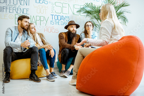 Obraz na plátně  Two young couples sitting during the psychological therapy with psychologist, so