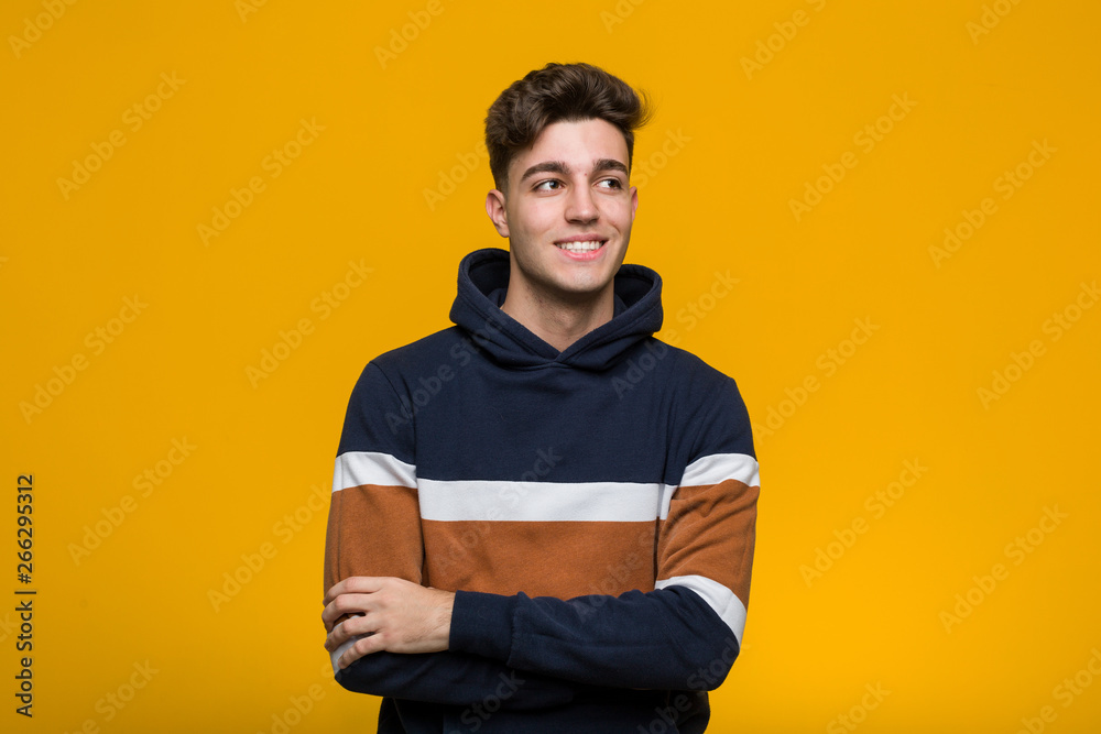 Fototapety, obrazy: Young cool man wearing a hoodie smiling confident with crossed arms.