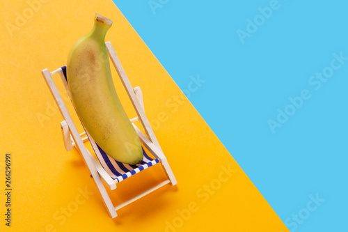 Strange In A Lounge Chair Lies A Banana As If Resting On A Blue Beatyapartments Chair Design Images Beatyapartmentscom