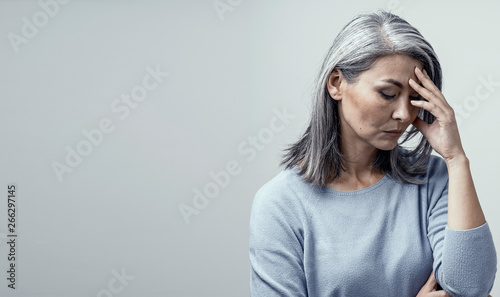 Canvastavla  Asian woman in distress on white background