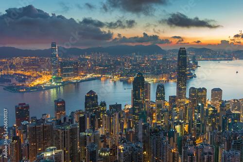 Fotografering  Victoria harbor of Hong Kong city at dawn