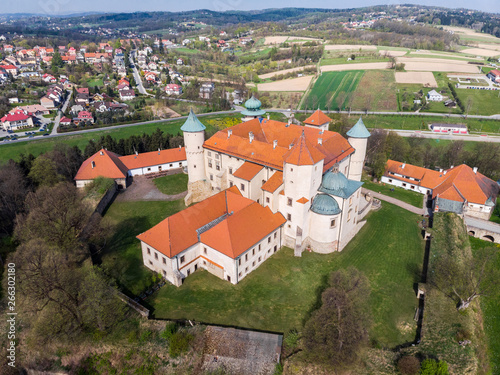 Renaissance Castle on the hill in Nowy Wiśnicz, Poland, aerial drone view. - fototapety na wymiar