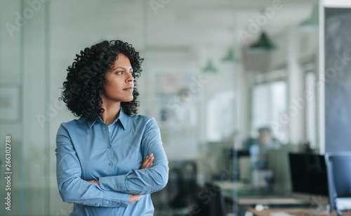 Fotografía Focused young businesswoman standing alone in an office