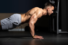 Model Doing Press Ups In Gym