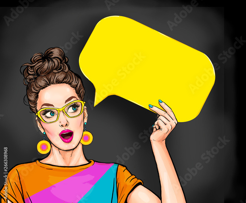 Amazed young sexy woman with open mouth looking up on empty yellow bubble.Pop Art girl is thought and holding message cloud.