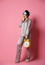 Young Woman In Pajama Just Aft...