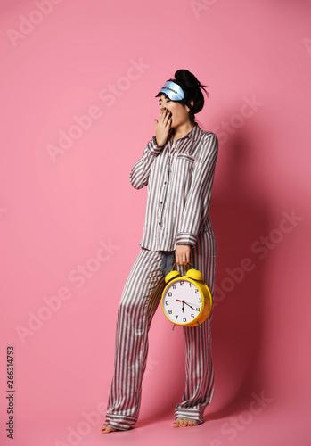 ec36b342e17 Young woman in pajama just after sleep woke up with sleepy bandage ...