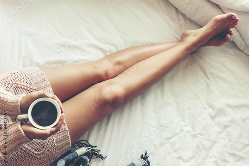 Close up legs women on white bed Wallpaper Mural
