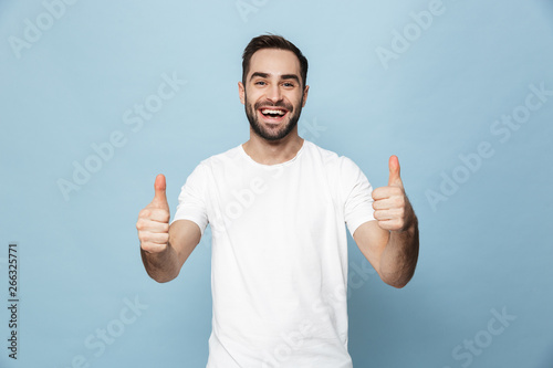 Fototapeta Cheerful excited man wearing blank t-shirt standing obraz na płótnie