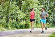 Leinwandbild Motiv Happy couple running in park