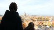Woman with her daughter admire beautiful Rome view