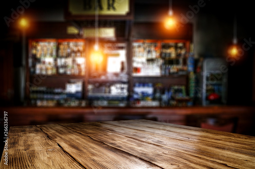 Obraz Table background of free space and blurred background of bar  - fototapety do salonu