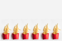 French Fries In A Carton Box Or Red Paper Pouch Isolated With White Background