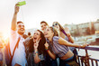 canvas print picture - Happy young friends taking selfie on street