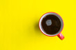 canvas print picture - cup of coffee on yellow background. soft focus.