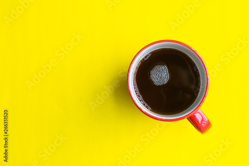 Fotografie, Obraz  cup of coffee on yellow background. soft focus.
